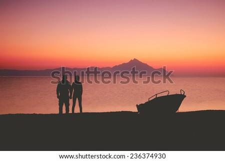 Couple on the sunset - stock photo