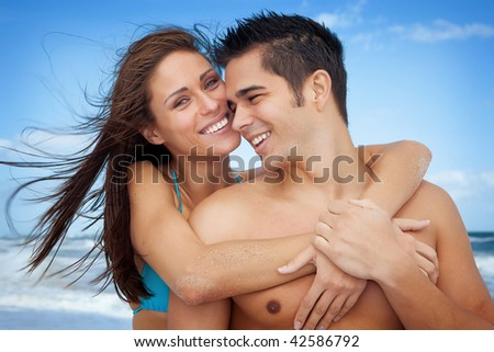 Couple on vacation at the ocean, both smiling