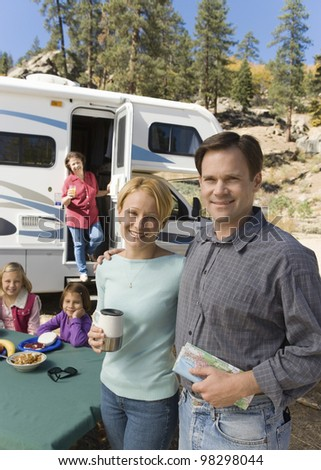 Couple on Vacation with Family - stock photo