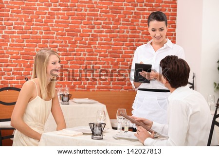 Couple ordering food in restaurant
