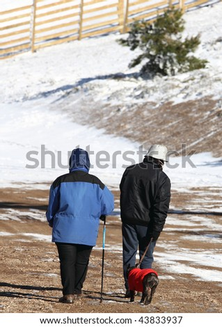Couple out for a walk with their dog. Javalambre sky run.Teruel province.Aragon.Spain - stock photo