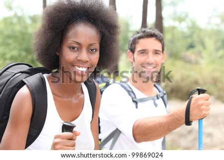 Couple out on a hike together - stock photo
