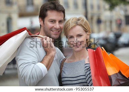 Couple out shopping together - stock photo