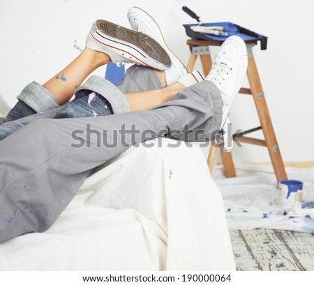 couple painting new home together with color - stock photo