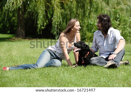 couple people with dog outdoor