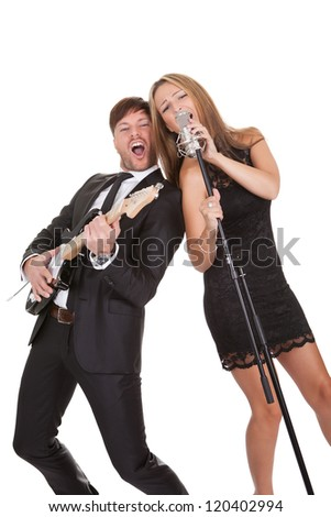 Couple performs duet sharing same microphone to everybody. - stock photo