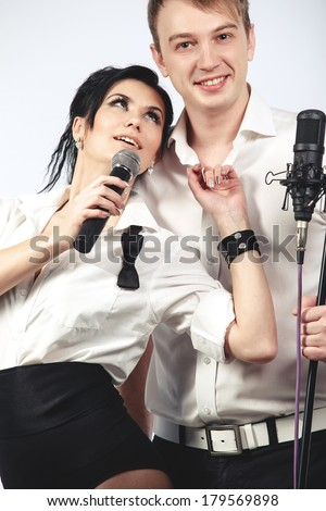Couple performs duet singing microphone over white - stock photo