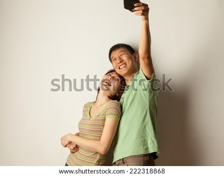 couple pictures of each other retro camera in the studio - stock photo