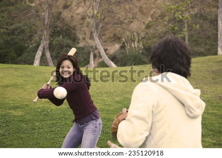 Couple Playing Baseball in Park - stock photo