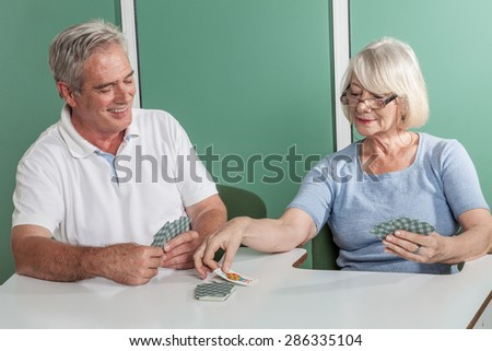 Couple playing cards - stock photo