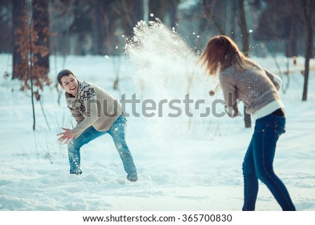 Couple playing snowball - stock photo