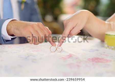 couple playing with rings at table - stock photo