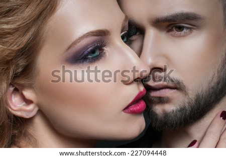 Couple portrait. Passionate couple in love.  Portrait of  beauty blond girl and her handsome boyfriend. Love. Kiss. Flirt.  Lovers. Valentines Day
