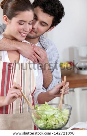 Couple preparing a nice salad - stock photo