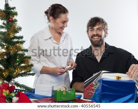 Couple preparing Christmas presents