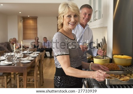 Couple Preparing Food For A Dinner Party - stock photo
