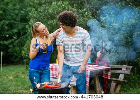 Couple preparing lunch for friends. - stock photo