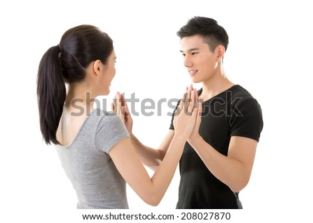 Couple put hands on hands, closeup portrait on white background.