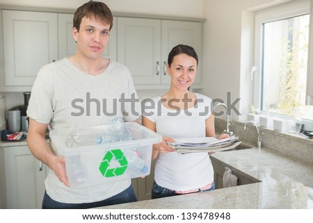 Couple recycling in kitchen