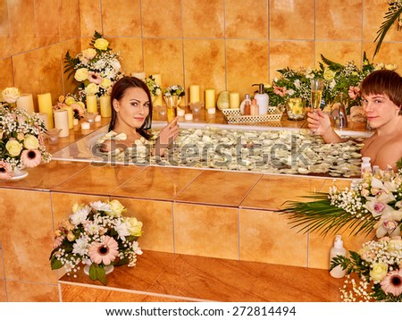 Couple relax  at luxury spa with flower and rose petal. - stock photo