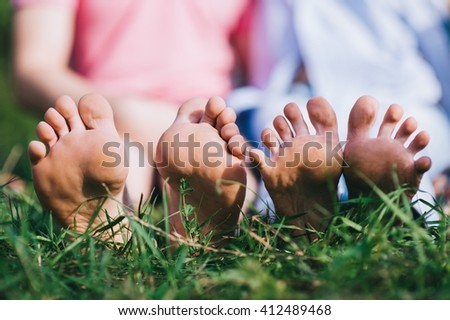 Couple Relax barefoot enjoy nature in the green lawn - stock photo