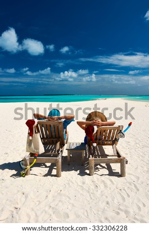 Couple relax on a tropical beach at christmas - stock photo