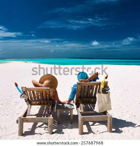 Couple relax on a tropical beach at Maldives - stock photo
