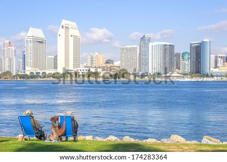 Couple relaxing and watching San Diego skyline - stock photo