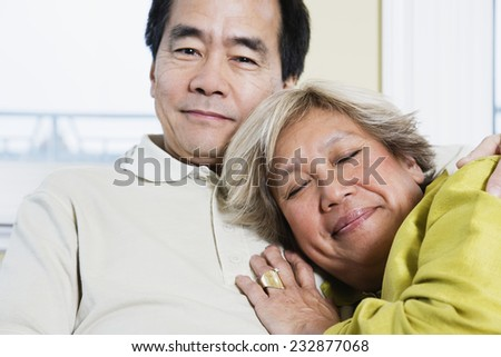 Couple Relaxing at Home - stock photo