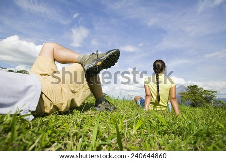 Couple Relaxing in the Grass - stock photo
