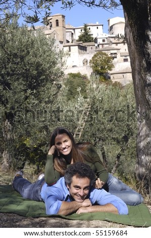 couple relaxing near the village of montefalco - stock photo