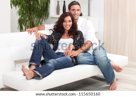 Couple relaxing on a soda - stock photo