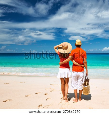 Couple relaxing on a tropical beach Anse Intendance at Seychelles, Mahe.  - stock photo