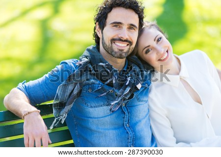 Couple relaxing outdoors - stock photo