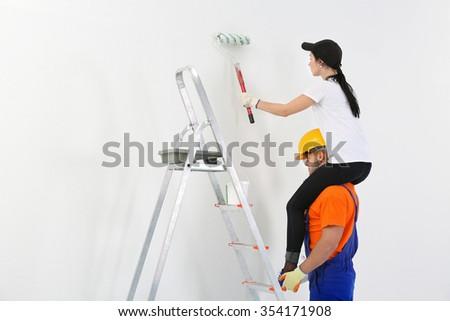 Couple renewing apartment indoor - stock photo
