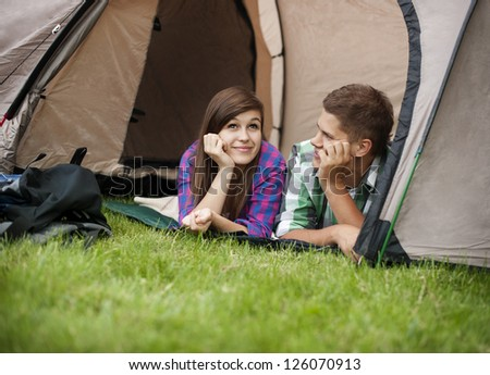 Couple resting in tent
