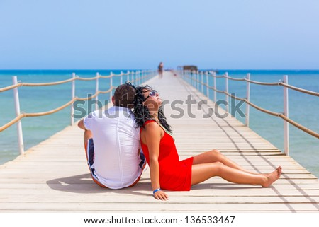 Couple resting on the pier of Red Sea, Egypt