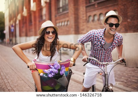 Couple riding bicycles in the city - stock photo
