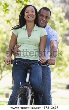 Couple riding bike - stock photo