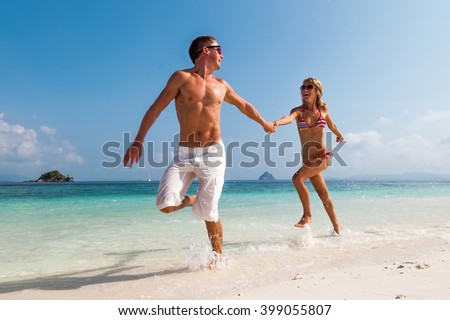 Couple running on the tropical beach
