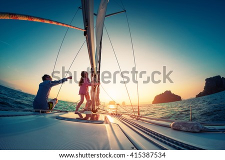 Couple sailing in the tropical sea - stock photo