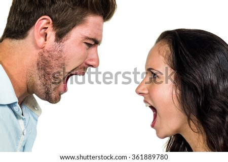 Couple screaming having argument over white background - stock photo