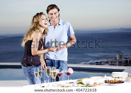 Couple sharing a joke at a party - stock photo