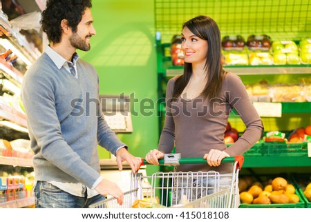Couple shopping in a supermarket - stock photo