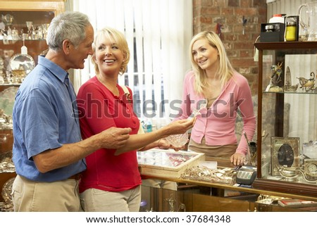 Couple shopping in antique shop - stock photo