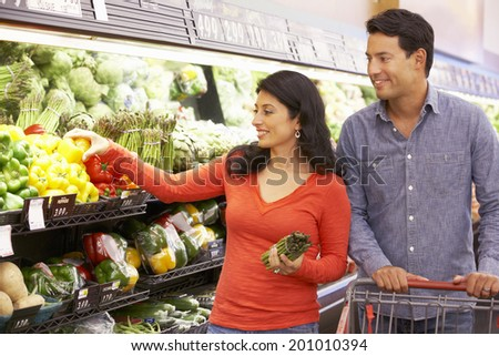Couple shopping in supermarket - stock photo