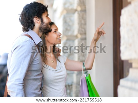 Couple shopping in the city - stock photo