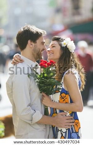 Couple shopping in the street - stock photo