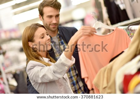 Couple shopping together in clothing store