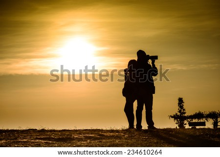 Couple silhouette, sunrise photo of love, photography and women - stock photo